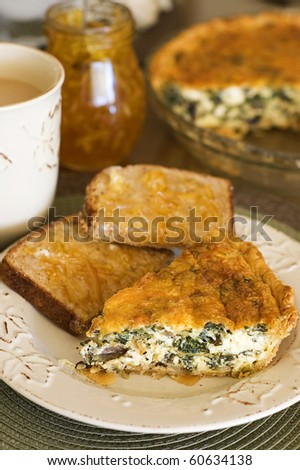 Spinach and Mushroom Quiche Breakfast with Whole Wheat Toast and Orange Marmalade and Hot Coffee - stock photo