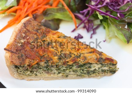 spinach and mushroom quiche with salad - stock photo