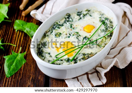 Spinach baked with cheese, egg and rice - stock photo
