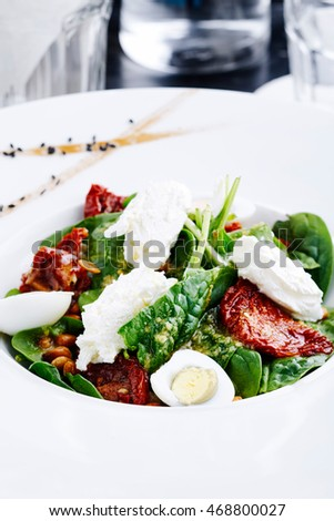 Spinach, cream cheese and sun-dried tomato salad. Philadelphia cheese and sun-dried tomatoes salad.