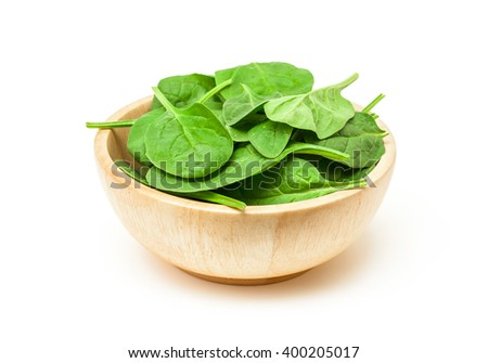 spinach green leaf in wooden bowl isolated on white background