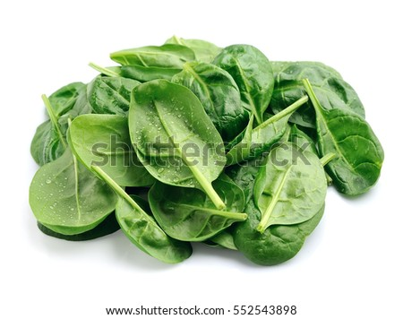 Spinach leaves with water drops close up isolated on white.