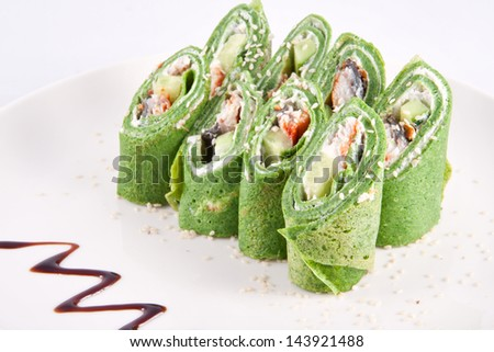 Spinach pancakes with smoked eel - stock photo