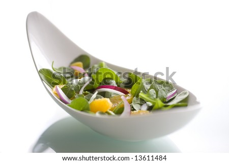 Spinach Salad in Odd Shaped Bowl - stock photo