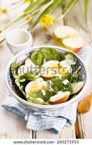 Spinach salad with hard boiled eggs and apple