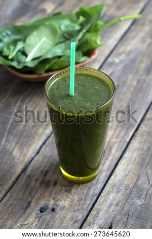 Spinach smoothie on the table, close up - stock photo