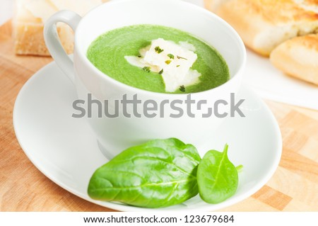 spinach soup with cream, parmesan cheese and crostini - stock photo