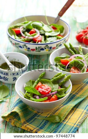 Spinach,tomato and  asparagus salad - stock photo