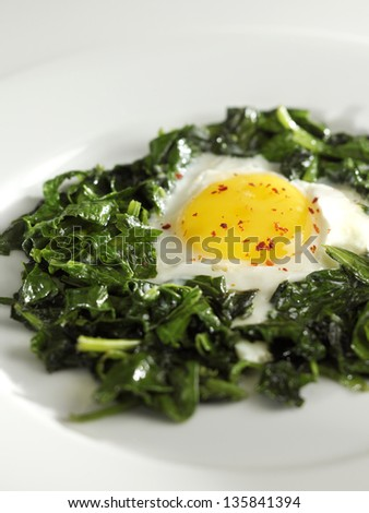 spinach with egg - stock photo