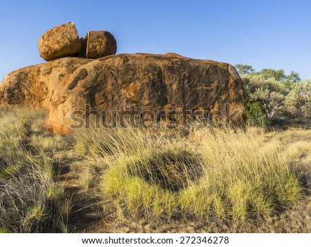 Spinifex grass circle, Devils Marbles, NT, Australia. - stock photo