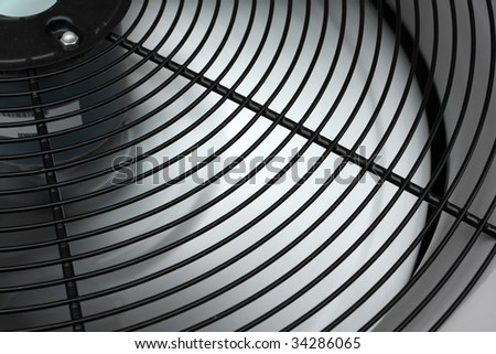 Spinning air conditioning fan - stock photo