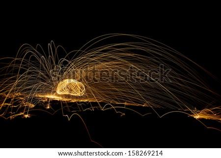 spinning burning steelwool   - stock photo