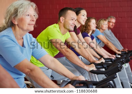 Spinning class exercising in a fitness center - stock photo