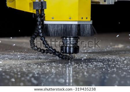 spinning cutting laser machinery - stock photo