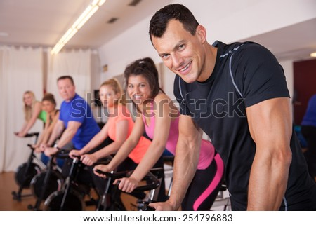 spinning - cycling group of fitness people