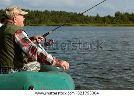 Spinning fisherman on a boat fishing