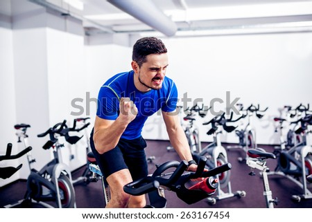 Spinning Instructor at Gym - stock photo