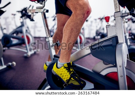 Spinning Instructor Detail at Gym - stock photo