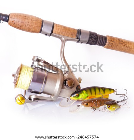 Spinning rod and reel with wobbler lure on white background - stock photo