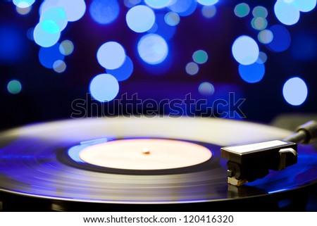 Spinning vinyl record. Motion blur image. - stock photo