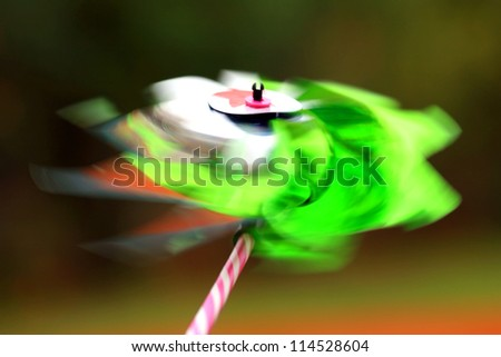 spinning wind toy motion blur - stock photo