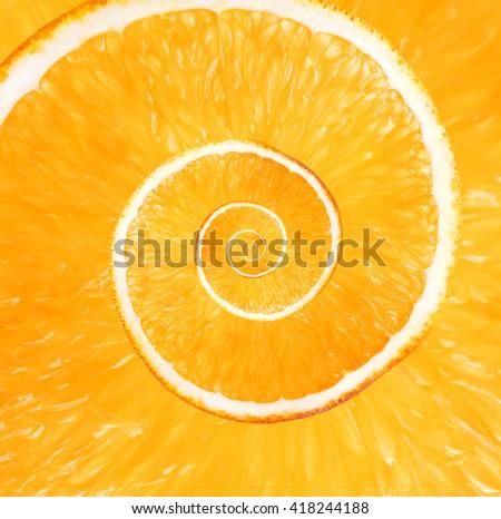 Spiral background made of juicy orange - stock photo