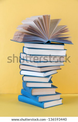 Spiral books on beige background