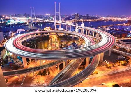 Spiral bridge in Shanghai Huangpu River on the bird's eye view of the beautiful night view - stock photo
