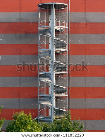 spiral fire escape stairs - stock photo