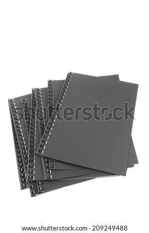 Spiral folders on plain background - stock photo