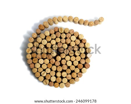 spiral from wine corks on a white background - stock photo