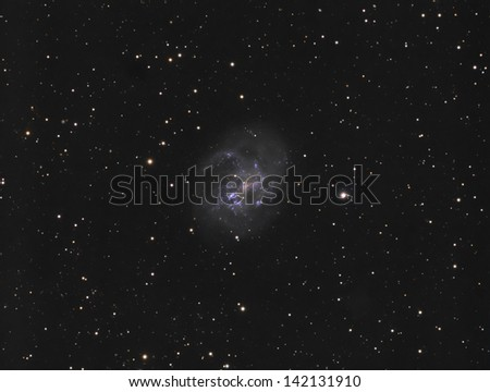 Spiral Galaxy NGC4395 - A face-on spiral galaxy about 26 million light years away in the constellation Canes Venatici - stock photo