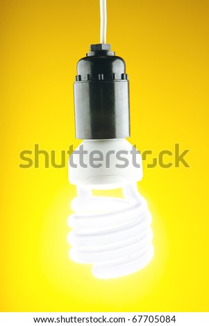 spiral lamp on a yellow background - stock photo