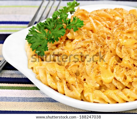 Spiral macaroni and cheddar cheese, macro with selective focus. - stock photo