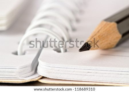 Spiral notebook and pencil - stock photo