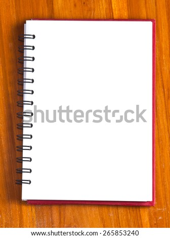 spiral notebook on a wood background  - stock photo