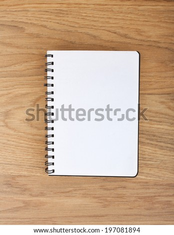 spiral notebook paper without line on a table - stock photo