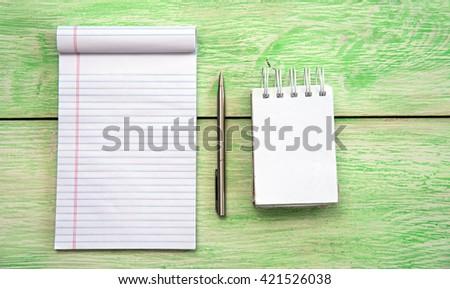 Spiral notebook. White blank notebook on grunge wood - stock photo