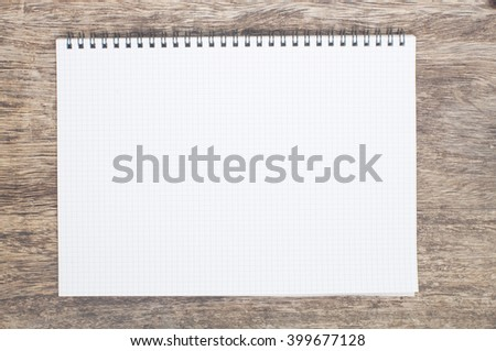 spiral notebook with clear pages on a wooden background