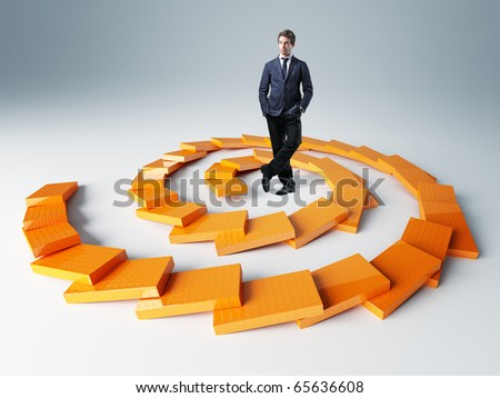 spiral orange 3d block and young businessman - stock photo