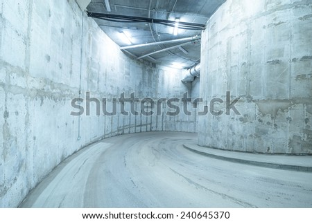 Spiral road to the underground mall garage. - stock photo