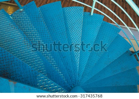 Spiral stair of footbridge with the sun ray light and shadow in daytime  - stock photo
