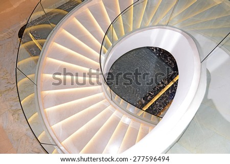 Spiral staircase in modern building. - stock photo