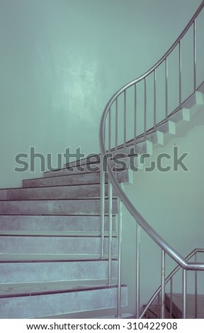 Spiral staircase of building. Vintage effect.