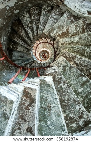 Spiral staircase on a old Lighthouse  - stock photo
