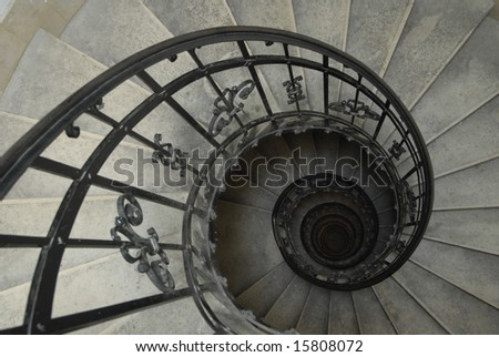 Spiral staircase with forged railing
