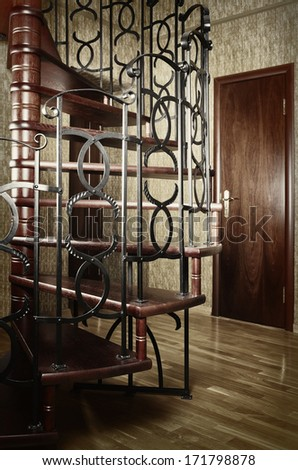 Spiral Staircase With Metal Railing In The Entrance Hall - stock photo