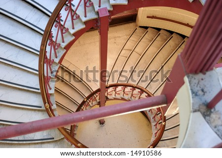 Spiral staircase with red railings in the Carnegie Library in Vancouver - stock photo