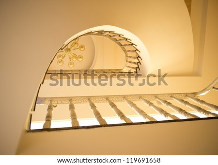 spiral staircase with wooden handrail. - stock photo