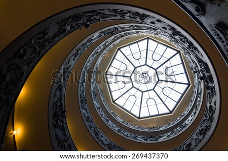 Spiral stairs of the Vatican Museums, designed by Giuseppe Momo in 1932. View from the bottom to up. Vatican City, Rome, Italy. - stock photo